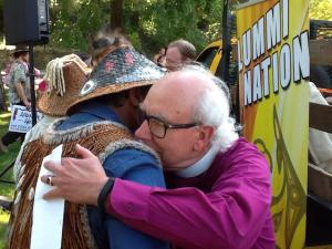 Bishop Waggoner hugs Doug James, Lummi Elder - photo Freddy Lane
