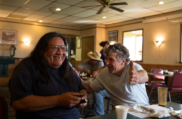 "Lakota George, of the Kul Wicasa Oyate, and Kurt Russo, a longtime Lummi Nation supporter, laugh about the ""Things Not to Say to an Indian on Your Vacation"" book idea."