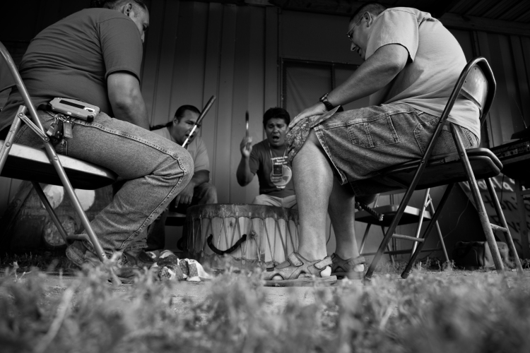 Kul Wicasa Warriors drumming during the August 23rd gathering at the Lower Brule Reservation.